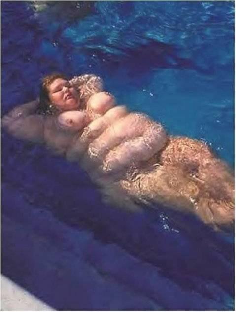 Žena na morju - foto