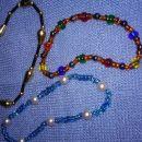 Zapestnice in ogrlice in uhani